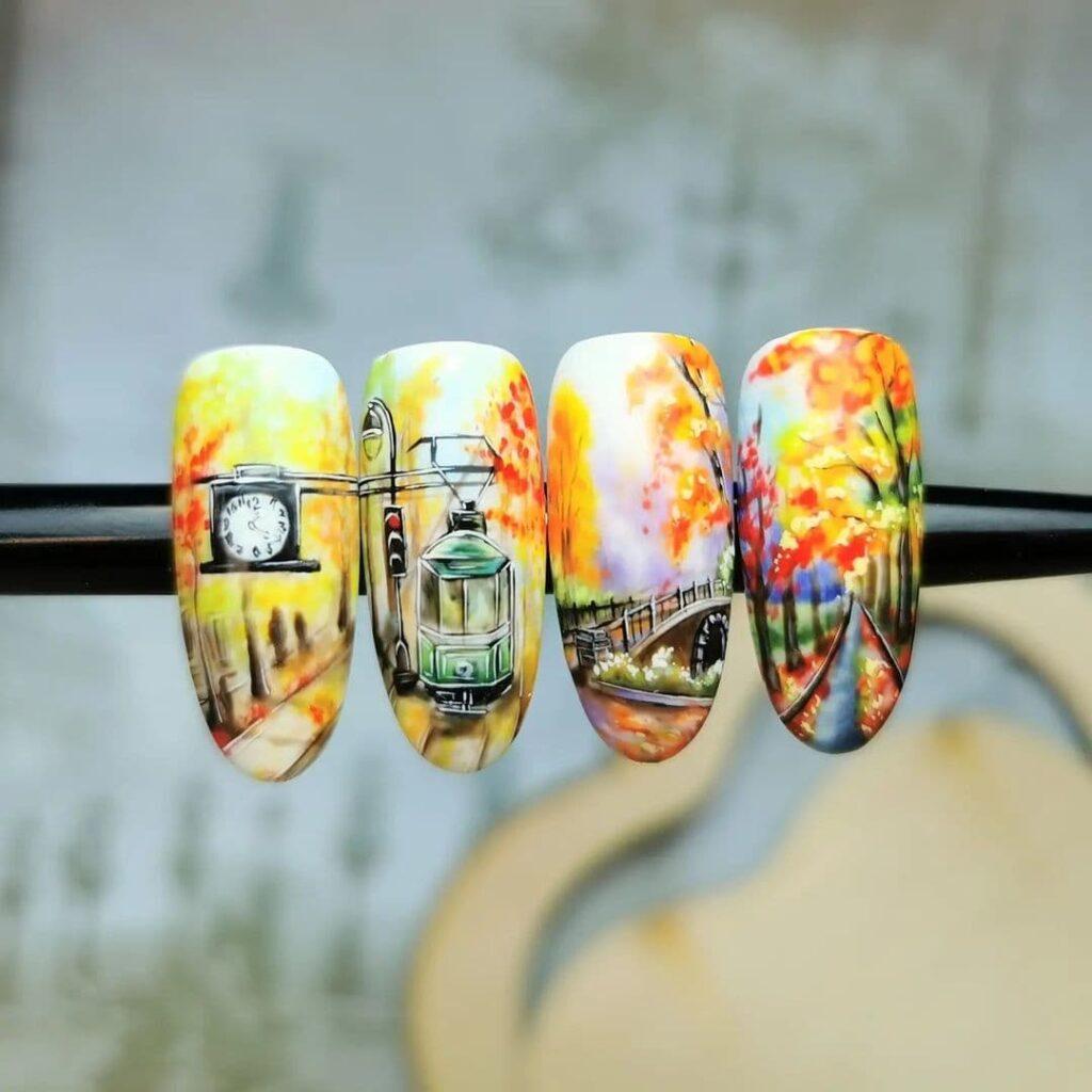 Осенний желто-красный маникюр с росписью на ногтях, трамвай, деревья
