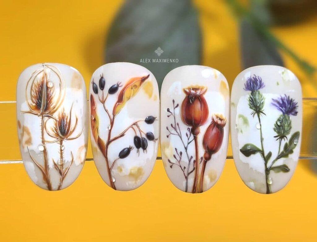 Работа от @alex_maximenko_nails Бежево-белый осенний маникюр с растениями, веточками, ягодами