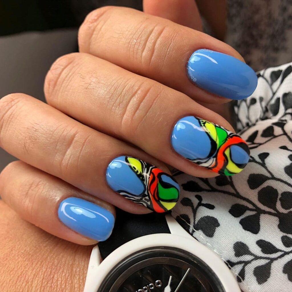 Работа от @beauty_house_poltava Текстурный голубой маникюр с цветными разводами